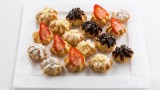 profiterole whith cream and chocolate and fruits